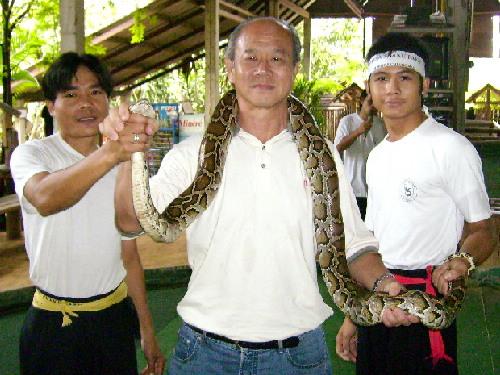 Writer holding a large python