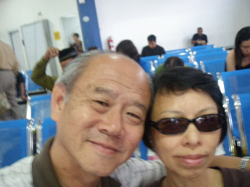 Writer and his wife waiting to board a ferry home at Batam Centre Ferry Terminal