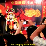 A changing mask show at Ba Gua Bu Yi Cuisine Restaurant, Hangzhou