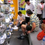 Buying shoes in a shop in Ding Pu Street, Hanjiang Town