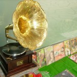 An antique gramophone and old records for sale
