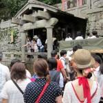 Visitors drinking water from Otowa Waterfall