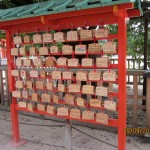 Visitors' wishes written on small wooden plaques