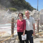 Writer and wife standing near the hot spring-pool