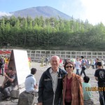Bare summit of Mt. Fuji behind writer and wife