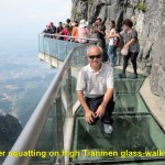 Writer squatting on Tianmen Glass-Walkway