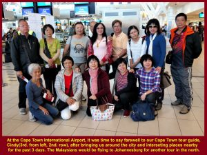Some fellow-Malaysians taking a farewell photo with Cindy, the Cape Town tour guide, at Cape Town Int'l Airport