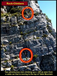 Two adventurous climbers climbing up Table Mountain as seen from the moving cable-car