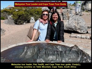 Malaysian tour group leader, Pek Yee(R), and Cape Town tour guide, Cindy(L), enjoying sunshine and fresh air on Table Mountain