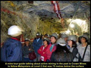 Mine tour-guide giving mining lesson to fellow-Malaysians at Level 2 of Shaft 14