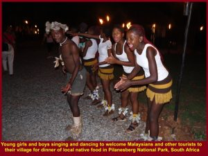 Young native boys and girls dancing and singing to welcome tourists for dinner. and entertaining them at the meal