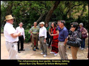 Johannesburg tour-guide, Graeme, talking about Sun City Resort to fellow-Malaysians