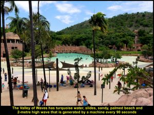 The Valley of Waves: water, sandy beach, slides, large waves and palm trees