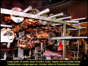 Large junks of exotic meat were roasted over a large open-air, circular stove at Carnivore Restaurant