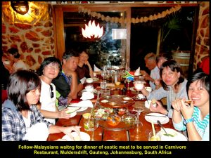 Fellow-Malaysians in happy mood before dinner of exotic meat at Carnivore Restaurant