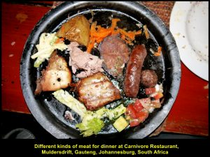 A hot-plate of exotic meat of zebra, impala and kudu, and domestic animals' meat. like chicken and pork