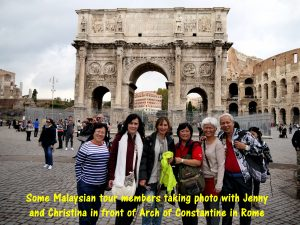 Taking photo in front of Arch of Constantine