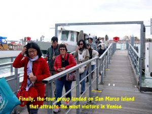 Tour group arriving on San Marco Island of Venice
