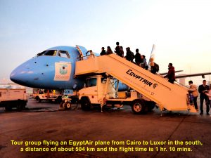 Tour group boarding EgyptAir plane that flies them to Luxor from Cairo