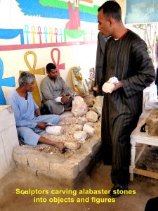 Sculptors carving alabaster stones into objects and figures