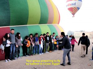 Tour group getting ready for hot air balloon ride in Luxor