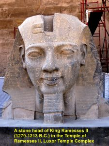 A stone head of King Ramesses II in the Temple of Ramesses II, Luxor
