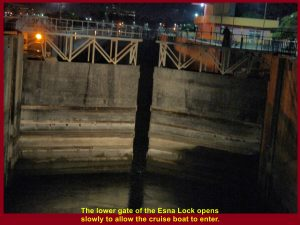 The lower gate of the Esna Lock opens slowly to allow the cruise boat to enter.