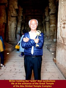 "Writer holding ""ankh"" that symbolises life at the entrance of the Great Temple"