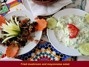 Fried mushroom and salad with mayonnaise