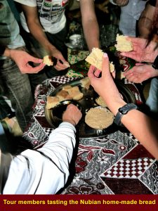 Tour group tasting Nubian bread at a senior's house