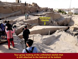 Tour group looking at the unfinished obelisk
