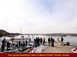 Tour group taking a motor-boat to Agilkia Island from the Marina Philae Temple jetty in Aswan