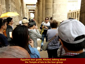 Egyptian tour guide, Khaled, telling the tour group about the Temple of Isis