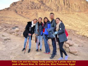 Peter Lim and his happy family posing for a photo at the rest shelter