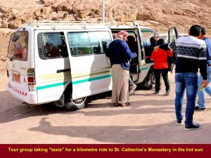 Tour group taking a kilometre-taxi ride to St. Catherine's Monastery in the hot sun