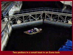 Two pedlars in a boat in Esnu lock