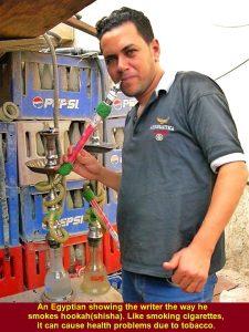 An Egyptian showing the writer the way he smokes shisha. Like smoking cigarettes, smoking shisha can cause health problems due to tobacco.