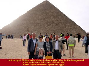 Pyramid of Khufu behind writer, wife , brother and sister-in-law is the oldest, largest and tallest pyramid in Egypt