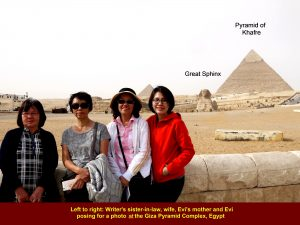 Writer's wife and tour members posing for a photo in front of the Great Sphinx, Giza Pyramid Complex, Egypt