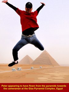 Peter Lim, a tour member, appearing to have flown from the pyramids to the cameraman